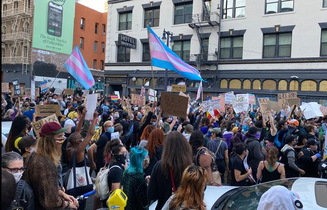 A crowd arrives in the Tenderloin June 18 during a march for Black trans lives. At least two protest marches are scheduled for June 28, when the in-person San Francisco Pride parade would have taken place. Photo: John Ferrannini