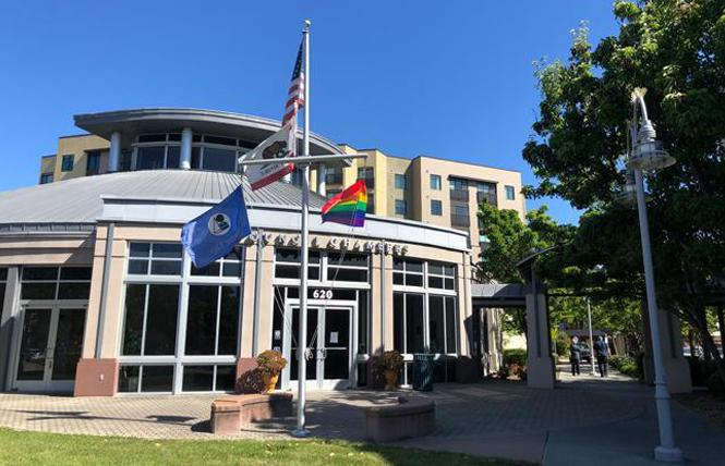 Foster City staff borrowed the rainbow flag from Island United UCC Church and raised it June 16 in front of City Hall. Photo: Courtesy Foster City