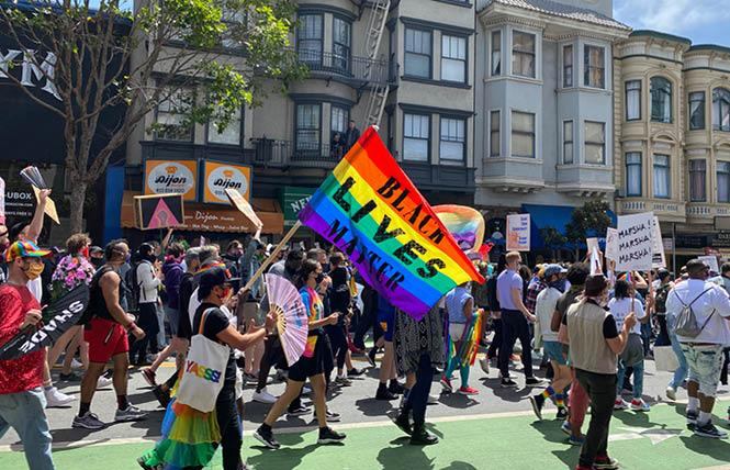 Hundreds of people took part in the People's March on Polk Street at California and Pine streets Sunday, June 28. Photo: John Ferrannini