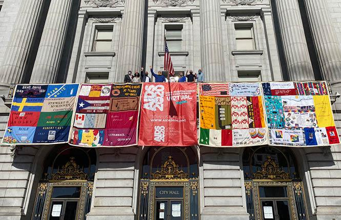 Panels of the AIDS Memorial Quilt were unfurled from San Francisco City Hall Monday, July 6, at the start of the now-virtual International AIDS Conference. Photo: Liz Highleyman