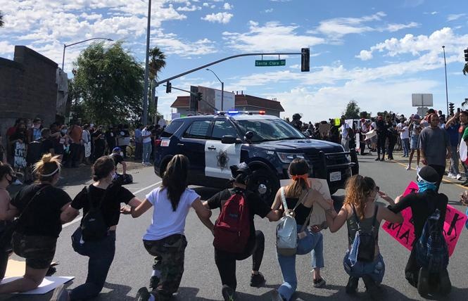 "South Bay Assembly candidate Alex Lee took this photo in San Jose during protests against the police May 29. ""We're Linked together as riot gear police show up,"" he wrote on Twitter. Photo: Alex Lee"