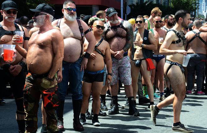 Last year's Up Your Alley street fair was a sea of men; this year will be a virtual affair. Photo: Rick Gerharter