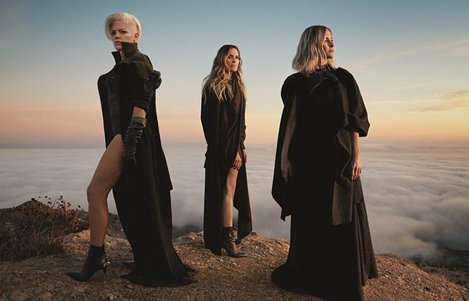 Natalie Maines, Emily Robison and Martie Maguire atop a scenic hill. photo: Columbia Records