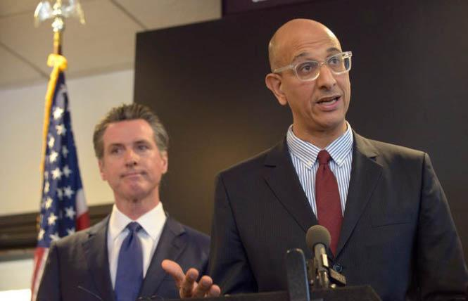 Dr. Mark Ghaly, right, shown here with Governor Gavin Newsom at an earlier press briefing, announced Tuesday that SOGI data would be collected for COVID-19. Photo: Courtesy AP