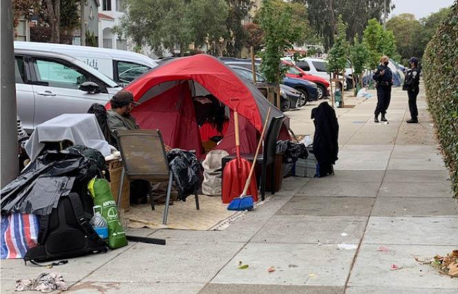 City officials gathered at the site of a homeless encampment Tuesday morning. Photo: Sari Staver