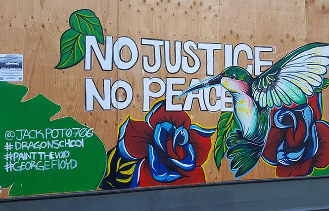 A mural was created on Broadway in Oakland after the Black Lives Matter protests earlier this summer. Photo: Cynthia Laird