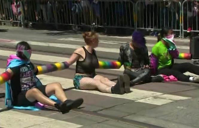 Protesters blocked the San Francisco Pride parade June 30, 2019. One of two people who were arrested, but who said they were not blocking the street, has sued the city of San Francisco in federal court. Photo: Courtesy ABC7 News