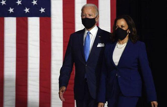 Joe Biden and Kamala Harris wore masks as they arrived to meet the press August 12. Photo: Courtesy CBS News