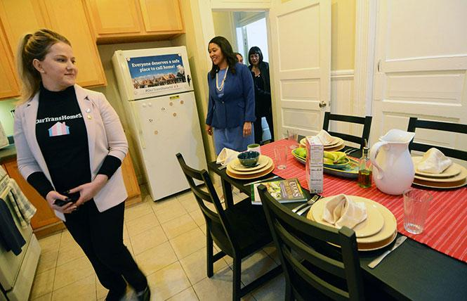 Clair Farley, left, from the Office Transgender Initiatives, and Mayor London Breed checked out the new kitchen at Our Trans Home SF during a January tour. Photo: Rick Gerharter