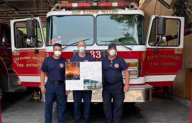 Jonathan Cook posted a photo from one of his neighbors thanking firefighters from Contra Costa County house engine 86 and San Ramon Valley house engines 33 and 34 for saving their Fairfield neighborhood last week. Photo: Courtesy Facebook