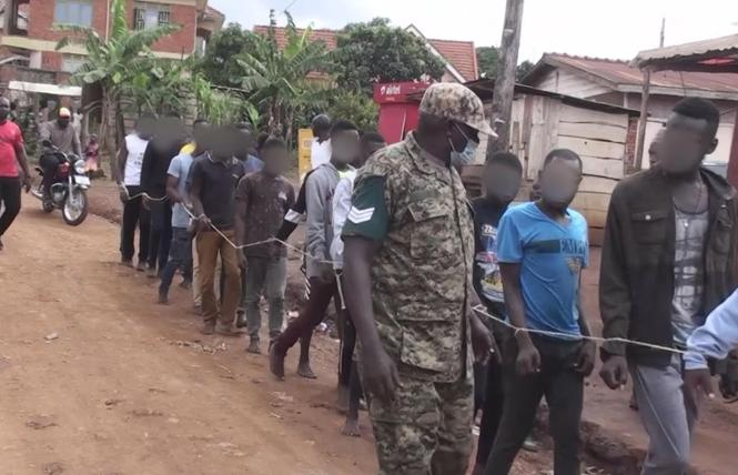Ugandan Police and local officials bound the hands of young shelter residents and tied them together in a human chain in March. Photo: Courtesy Sky News