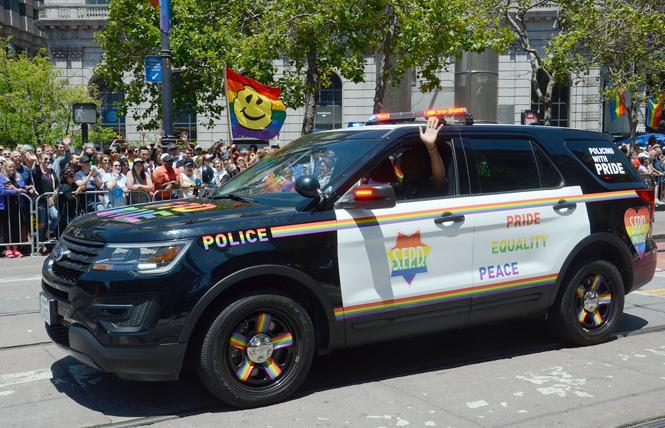 The San Francisco Police Department's rainbow-decorated patrol car made an appearance in the 2019 San Francisco LGBT Pride parade. Photo: Rick Gerharter