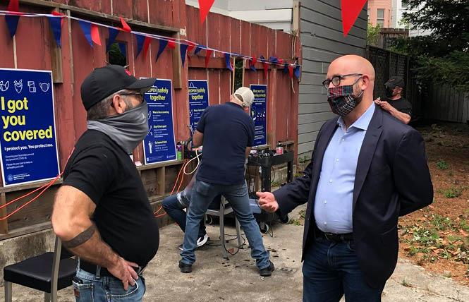 Joe Gallagher, left, talks with District 8 Supervisor Rafael Mandelman in the backyard of Joe's Barbershop ahead of personal services, including barber shops, gyms, fitness centers being allowed to resume indoor service — with restrictions — September 14. Photo: Courtesy Rafael Mandelman/Facebook