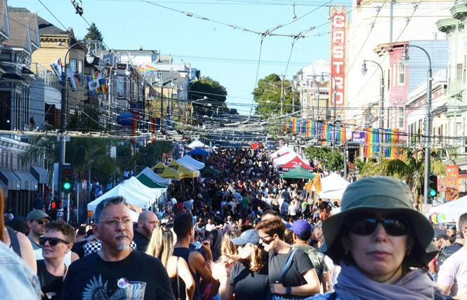 Crowds filled Castro Street during the 2018 fair. This year there will be a scavenger hunt people can access on their phones, and T-shirt sales to benefit nonprofits. Photo: Rick Gerharter