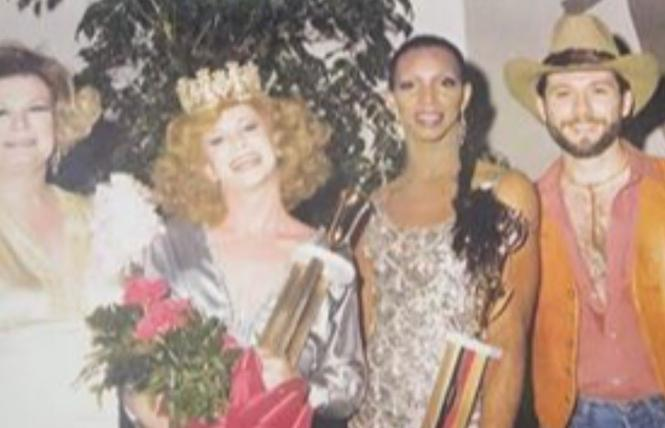 A photo from the Miss Gay Alabama pageant for 1980, taken in 1979 at the Ram's Head, a gay bar in Birmingham. In the image, from left, are Barbara Jean (Lady BJ), Mandy Lynn, and Bronzie De'Marco, who has been a drag performer in Alabama for more than 50 years. The man at right is unidentified. Photo: Courtesy Invisible Histories Project
