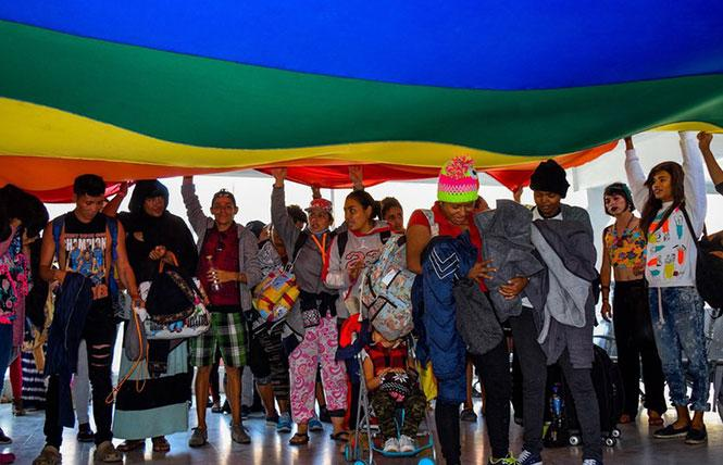 LGBTQ asylum seekers from El Salvador, Guatemala, and Honduras arrived in a rainbow caravan in November 2018. Photo: Courtesy of the European Photopress Agency