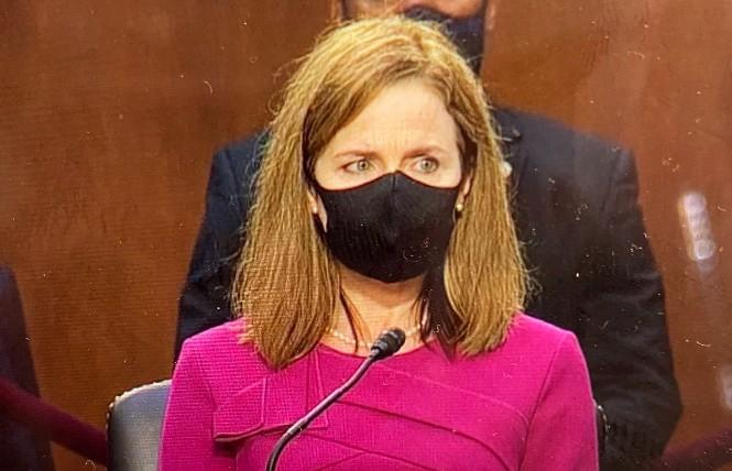 Federal Judge Amy Coney Barrett wore a mask when she was not speaking during the first day of her Supreme Court confirmation hearing Monday, October 12. Photo: Screengrab via CNN