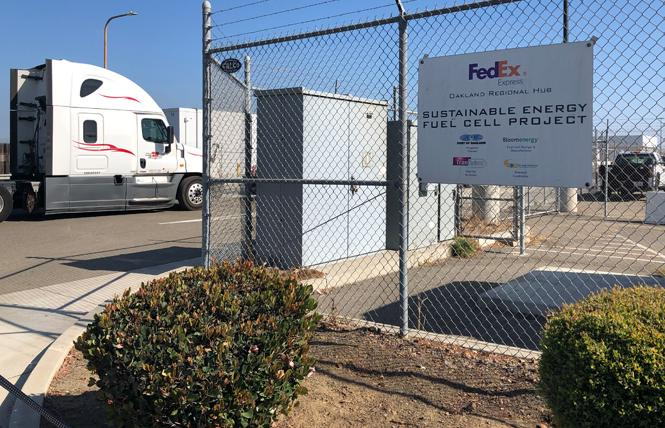 A cargo truck waits on Sally Ride Way to enter the secure FedEx facility at Oakland International Airport. Photo: Matthew S. Bajko