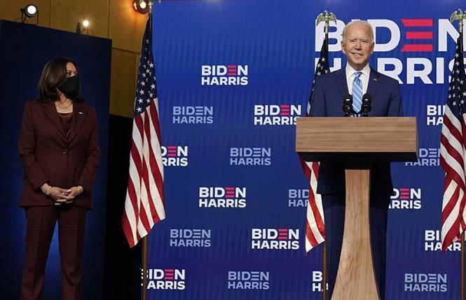 Joe Biden addresses reporters Wednesday in Wilmington, Delaware with his running mate, Senator Kamala Harris. Photo: Courtesy AP