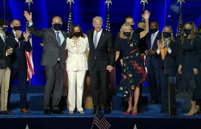 Doug Emhoff and his wife, Vice President-elect Kamala Harris, joined President-elect Joe Biden and his wife, Jill, during their victory speech November 7 in Wilmington, Delaware. Photo: Courtesy CBS