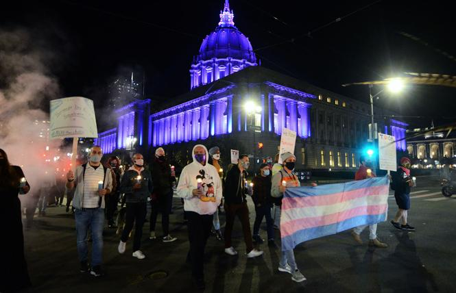 San Francisco City Hall was lit with the colors of the transgender flag during a march observing the Transgender Day of Remembrance Monday, November 16. Photo: Rick Gerharter