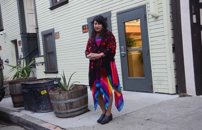 Adriana Kin Romero stands outside of Casa Quezada. Photo: Rick Gerharter