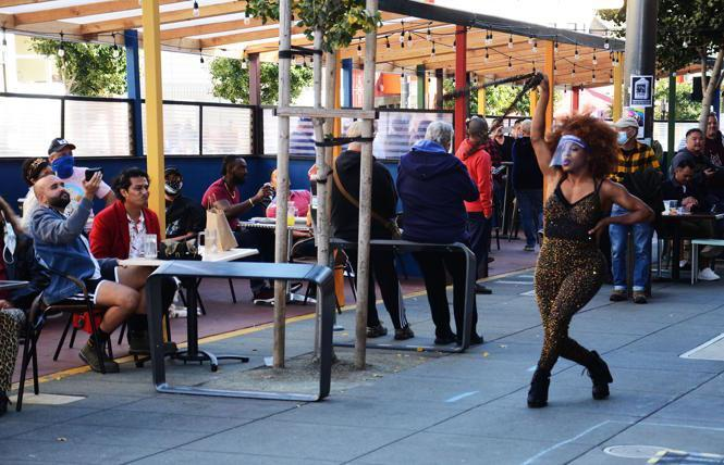 Outdoor dining, such as this October scene in the Castro featuring drag performer Militia Scunt, right, will end Sunday night in San Francisco and several other Bay Area jurisdictions under new stay-home orders. Photo: Rick Gerharter