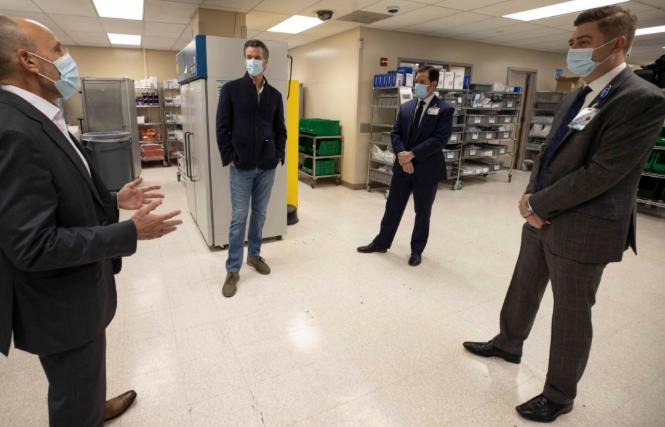 Governor Gavin Newsom, second from left, on December 11 visited an ultra-low temperature storage facility at UC Davis Medical Center, which is preparing for the imminent arrival of the Pfizer COVID-19 vaccine. Photo: Courtesy Governor's Office