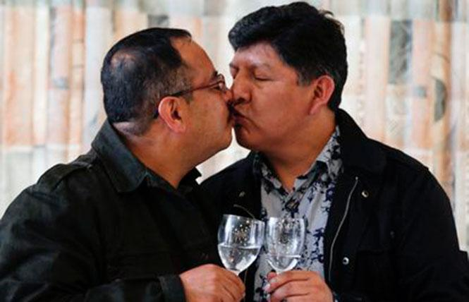 Guido Montano, left, and his partner, David Aruquipa, kissed during a news conference in La Paz, Bolivia, on December 11. Photo: Juan Karita/AP