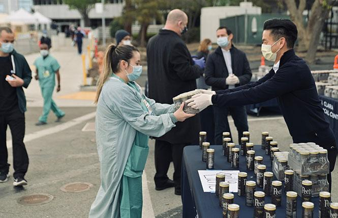 Assemblyman Evan Low, right, hands out coffee to frontline health care workers at Valley Medical Center in San Jose. Photo: Courtesy Assemblyman Low's office