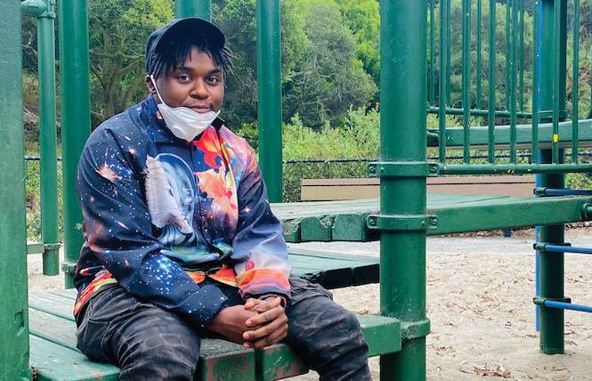 Chef Avery Hines sits on a bench at Buena Vista Park in San Francisco. Photo: Truc Nguyen