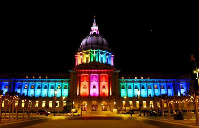 San Francisco City Hall was lit in rainbow colors last year to honor the life of lesbian pioneer Phyllis Lyon, who died April 9. Photo: Steven Underhill