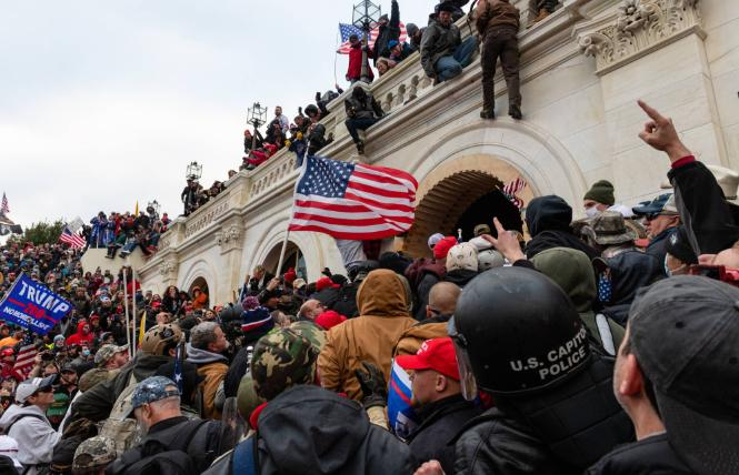 Members of a pro-Trump mob attempt to enter the U.S. Capitol building in Washington on Wednesday, January 6. Photo: Courtesy Bloomberg
