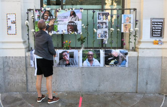 A person paid tribute to deceased community members outside the Castro Bank of America branch January 18. Photo: Gerard Koskovich