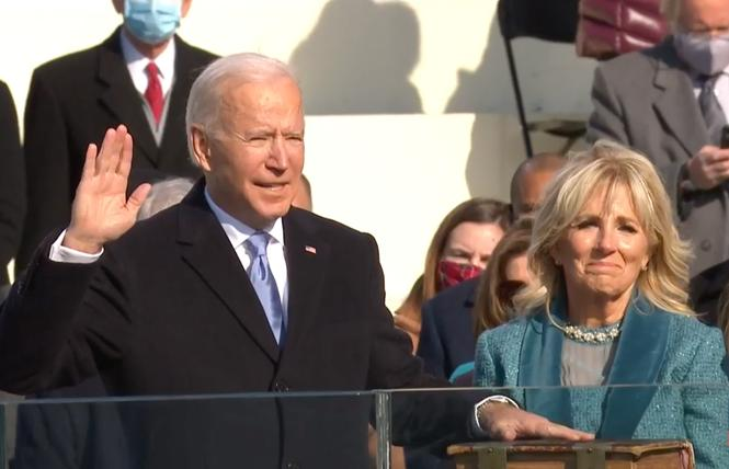 Joe Biden takes the oath of office January 20 while his wife, Jill, holds the Bible. Photo: Screengrab