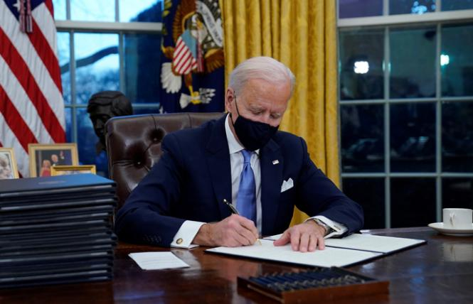 President Joe Biden signed 17 executive orders on his first day in office. Photo: AP