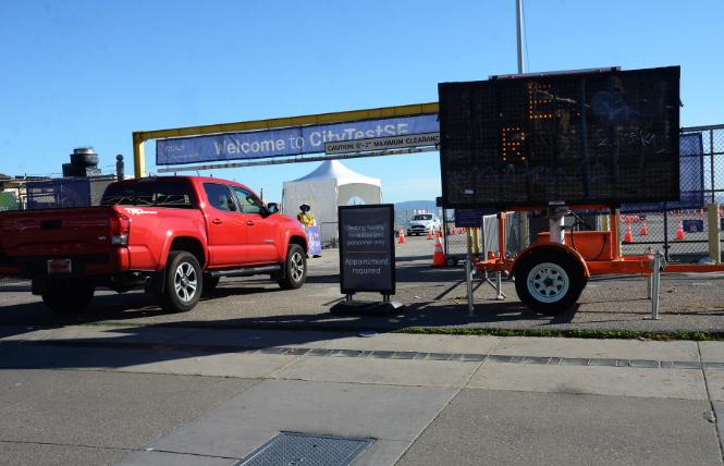 A vehicle enters the drive-in entrance to San Francisco's COVID testing site at Pier 30. Photo: Rick Gerharter