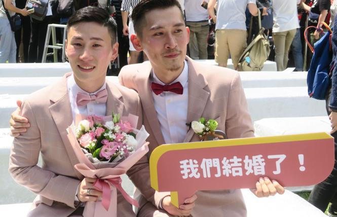 A gay couple celebrates Taiwan legalizing same-sex marriage in 2019. Photo: Courtesy Kyodo News
