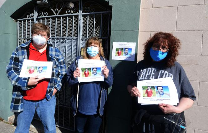 Three siblings of Christopher Woitel, brother Frank Woitel, left, and sisters Lara Haven and Kathy Flynn, held fliers outside Woitel's San Francisco apartment February 12, asking for help in finding their brother, who has been missing since January 9. Photo: Rick Gerharter