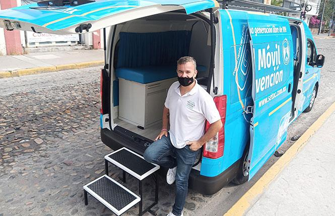 SETAC PrEP counselor and psychologist Omar Ismael Rossi stands in front of the center's van. Photo: Ed Walsh