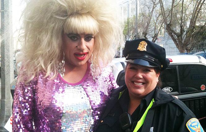 New Mission Station police Captain Rachel Moran, right, shared a moment with Heklina at the 2011 Pride parade. Photo: Courtesy SFPD