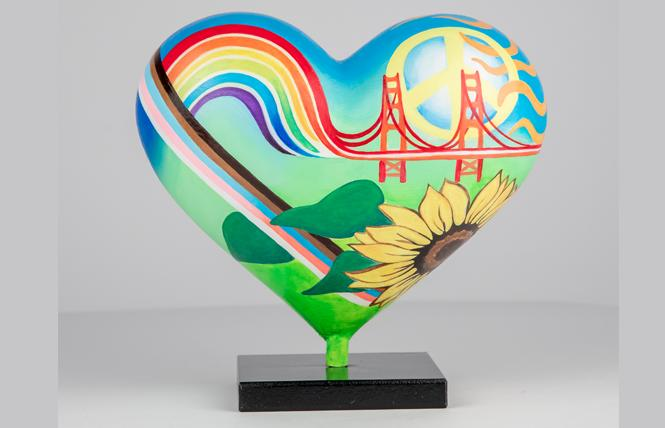 """The back of Bunny California's 2021 mini heart, entitled """"San Francisco Glow,"""" features the rainbow and trans flag colors. Photo: Courtesy SFGH Foundation"""