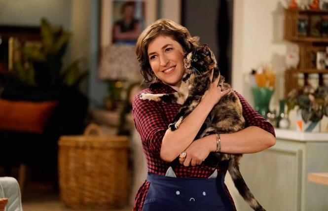 Mayim Bialik with a feline costar in 'Call My Kat'