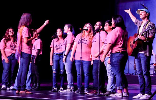 """Jason Mraz, right, joined artistic director Lindsey Deaton and members of the San Diego Queer Youth Chorus during """"Shine"""" in 2020. Photo: Courtesy San Diego Pride"""