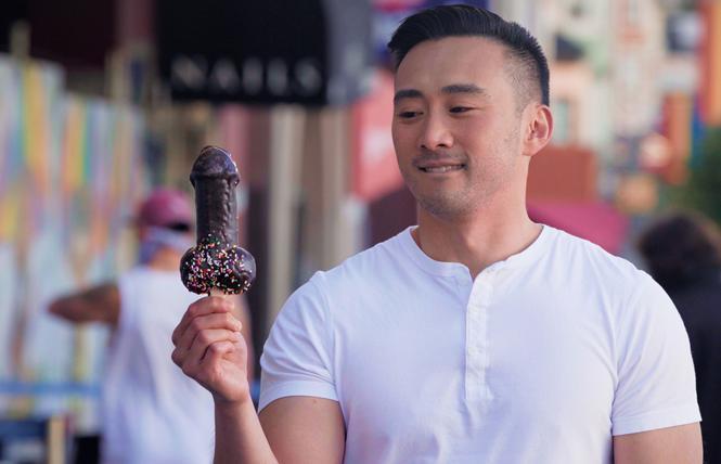 Filmmaker Alex Liu holds a penis-shaped lollipop. Photo: Courtesy Herra Productions