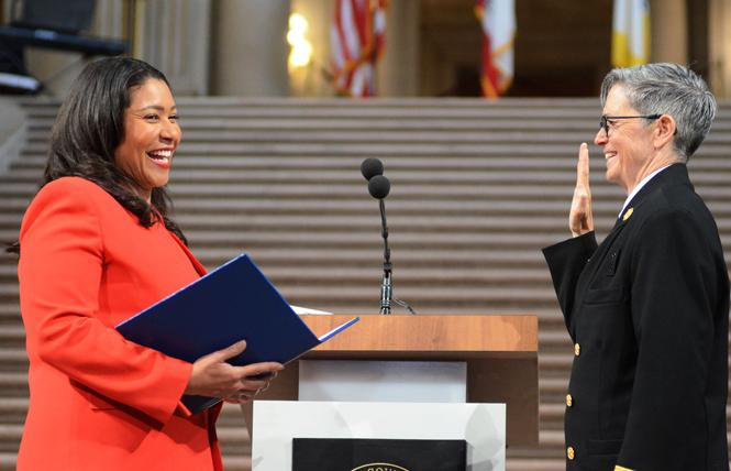 Mayor London Breed, left, administered the oath of office to San Francisco Fire Chief Jeanine Nicholson during a May 2019 ceremony in City Hall. Photo: Rick Gerharter