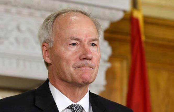 """Arkansas Governor Asa Hutchinson signed an anti-trans bill into law March 25, which will lead to the state being added to California's """"no-fly"""" list for publicly-funded travel. Photo: AP"""