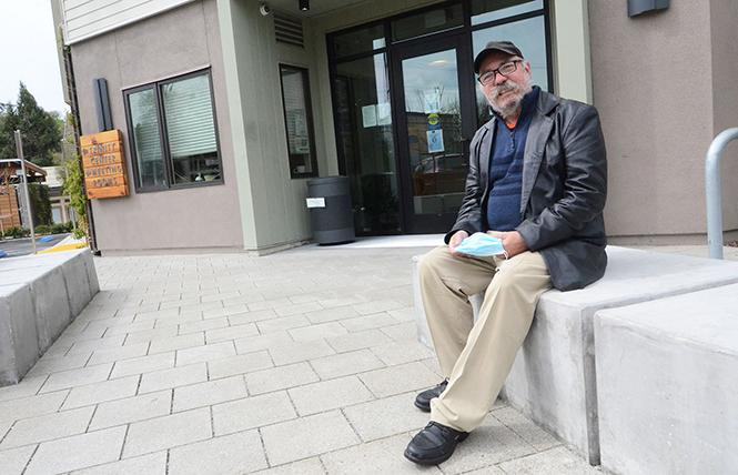Charlie Uher sits in front of his apartment building in Walnut Creek. Photo: Rick Gerharter