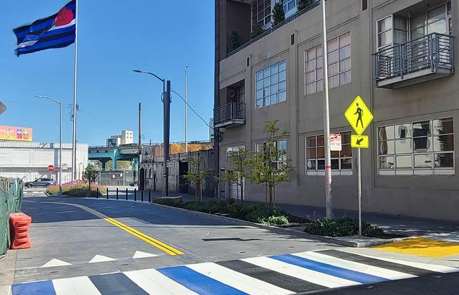 A new crosswalk sporting the blue, white, and black colors of the leather flag now marks the start of the Eagle Plaza public parklet on 12th Street at Bernice. Photo: Courtesy Leather & LGBTQ Cultural District