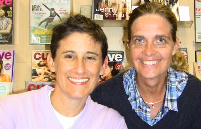 "Frances ""Franco"" Stevens, left, and Silke Bader, Avalon Media CEO, right, when Curve was sold to the Australian lesbian media company in 2010. Photo: Courtesy Avalon Media"
